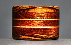 Making a wooden ring that is a little different is one way to create interest about your project. This is a very long ring, which is still easy to wear, but showcases a lot more wood. More on my site by clicking on the picture.