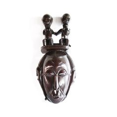 Source Mask Baule With Twin Statues in Headgear by House of Avana French Colonial, African Masks, Headgear, Luxury Interior, Wood Grain, Hand Carved, Twins, Sculptures, Statues