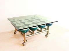 "My ""Spare Table"" made of Brunswick bowling balls. steel, glass and locking non-marring casters."