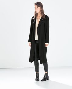 LONG FLOWY COAT from Zara.  I tried this on this evening and it was a cute staple. UPDATE: Bought this!