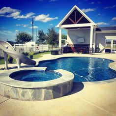 #radius #pool with #slide and #spa #hottub #flagstone #coping #preferredpools #tyler #construction #builder #easttexaa #backyard #oasis
