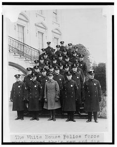 The White House police force which doned  their new and distinctive uniforms today - photographed on the s. portico of the White House.  c. 1923