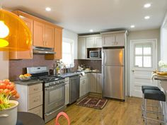 Small-Kitchen Design Tips : Home Improvement : DIY Network Smart Use of Color Bright orange cabinets and decor move the eye around the room, a trick to make the space appear bigger. Design by Kitchen Cousins Kitchen Cabinet Inspiration, Kitchen Cabinet Colors, Kitchen Colors, Kitchen Decor, Kitchen Cabinets, Kitchen Ideas, Upper Cabinets, Neutral Kitchen, Kitchen Walls
