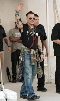 Happy: Johnny Depp was all smiles as he arrived for his band's gig at Coney Island in New York on Sunday night