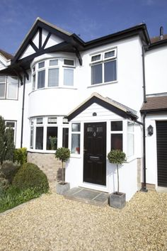 Entrance porch on semi-detached house with round bay windows