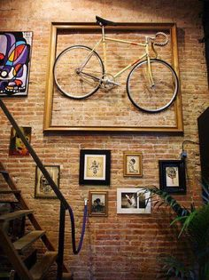 If you're a bike lover, here's a wonderful storage solution idea for your two favorite wheels… Add bike hooks to your wall and anchor it with an oversize, empty custom frame! It creates a super unique look and turns your bike into a work of art; now you won't mind it being out in the open in your space! However, for easier access, we suggest hanging your bike at a more manageable height. Happy biking!