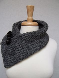 Knitted Gray Cowl , Buttoned Scarf Scarflette.    This gorgeous Gray loom-knit cowl is light as air yet warm and cozy. Made of a soft acrylic yarn, the cowl is loosely knitted and uses two buttons as a closure, secured by a detachable crocheted stretchy button loop. Soft, comfy, and light as air, it will make any outfit look fabulous while keeping you toasty. Knitted with a soft, deliberate roll on the long ends, this scarf is 6 wide x 25 long.    Please note: buttons may vary. Ready to…