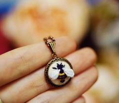 Little Bee Hand embroidered necklaceMiniature by BlancAndJaune
