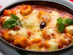Try this homemade gnocchi slow-cooked recipe. This simple gnocchi is cooked with a homemade tomato sauce with melted mozzarella on top. Slow Cooker Recipes, Crockpot Recipes, Cooking Recipes, Healthy Recipes, Baked Gnocchi, Gnocchi Soup, Tortellini Bake, Traditional Italian Dishes, Good Food Channel