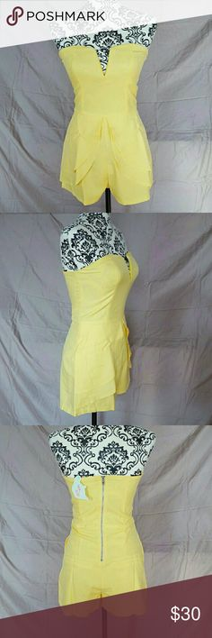 "Yellow Peplum Romper Size Medium. Strapless Yellow romper by Tea & Cup. Front skirted overlay. Slit pockets on the sides and back. Back zipper. There is a very slight stretch to it but not much.   💘Measurements:  Bust-16.5""  Waist-15""  Hips-18"" Tea n Cup Pants Jumpsuits & Rompers"