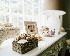 The Best Beach Houses Around the World: Intricately decorated shell boxes adorn a living room side table in Connecticut.