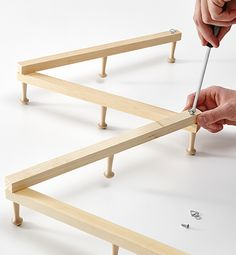 Senior Design Editor Joel Bray shares step-by-step instructions for a cottage-ready hat rack made from inexpensive wood and pegs. Let's face it: sto. Wall Mounted Hat Rack, Wall Hat Racks, Diy Hat Rack, Hygge, Hat Organization, Organizing, Hat Holder, Hanging Hats, Hat Storage