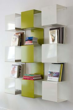 Square is a bookcase that attaches to the wall, and can be used for home or  office interior. Design: Anne Linde