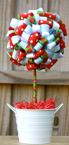 Cute Center pieces... Desperate Craftwives: Strawberry Birthday Party - I was thinking about this with the red and blue ribbons for the twins' party!