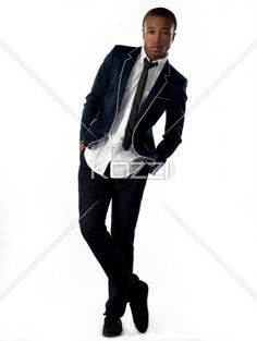 view of a business with legs crossed at ankles. - Portrait view of a businessman with legs crossed at ankles and hands in pockets over white background. Model: Nathaniel Stevenson