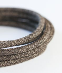 Textured brown fabric cable for lighting is part of our laid-back range of fabric cables. It's double insulated, CE certified, available in lengths 1-500m