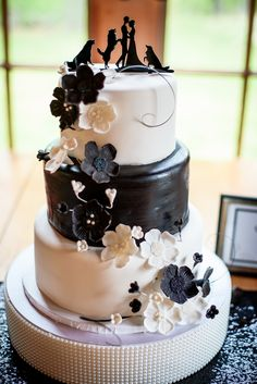 Beautiful black and white wedding cake with custom silhouette dog cake topper!