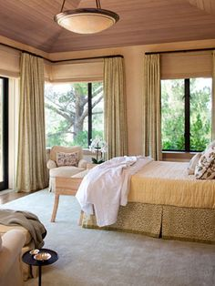 Designer Suzanne Tucker created this country house in California. A ceiling of natural cedar brings the outdoors in and creates texture and warmth in the master bedroom. The silk and linen Stark rug adds plush softness. Curtains and bed skirt are Leopard Wood Bedroom, Modern Bedroom, Bedroom Decor, Master Bedroom, Bedroom Ceiling, Bedroom Ideas, Earthy Bedroom, Outdoor Bedroom, Comfy Bedroom