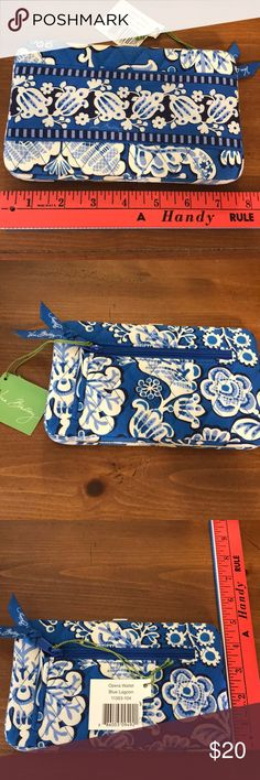 NWT -  Vera Bradley Fabric Wallet This Blue Lagoon blue & white pattern is on an opera style wallet.  It has slots for ID, credit cards, cash & change.  Perfect to carry alone or inside a purse for an evening out on the town. Bundle for a discount! Vera Bradley Bags Wallets