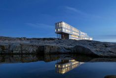 Fogo Island Inn, Newfoundland, Canada Fogo Island Inn is a hotel with a major wow factor that definitely deserves some exposure. The sharp structure rests atop stilts on the rocks of the Black Western Shore, looking impressive but eerie against the rugged, empty landscape. Inside, it's a completely different story. Each of the 29 suites is a colorful, charming oasis. There's also a striking restaurant with floor-to-ceiling glass windows, and even a cinema, too.