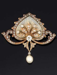 AN ART NOUVEAU DIAMOND, ENAMEL AND PEARL BROOCH. The central translucent enamel stylised lotus leaf with applied old brilliant and rose-cut diamond spray and rose-cut diamond edging, supported by twin rose-cut diamond scrolls, suspending a single pearl, circa 1900.