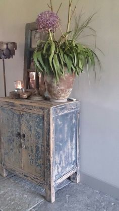Distressed Chinese cabinet