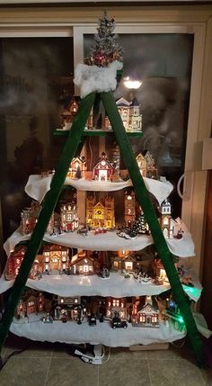 """Christmas Village Display Tree Idea - 2X3 frame w/ dimensions pulled from a ladder as sample - 12"""" boards for shelves.  Prim the paint down!"""