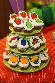 Chocolate cupcakes with All the food eaten by caterpillar as its design