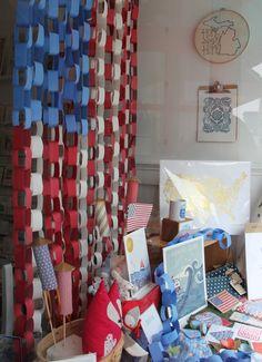 Poppins, Mackinac Island, MI. Window display. July 4th window display. Paper chain. Paper art.