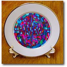 An original painting done by Jodie Herpel in blue, pink and green Plate