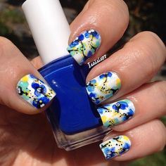 Shower your nails with lots of pretty watercolor flowers. To get this effect use a white base color so that you can freely choose colors for the flowers to go on top. With help from a black polish bring out more details on the flowers.