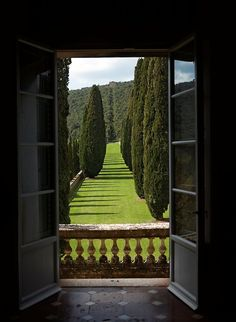The view at Villa Cetinale is artfully lined with towering cypresses, olive trees and impeccable gardens Siena