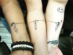 Connecting tattoos are also a really cute idea. This group of three used stick drawings of themselves, connected by a string telephone.