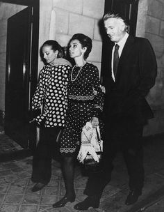 Audrey Hepburn with her beloved friends Capucine and Hubert de Givenchy after a dinner at Maxim's in Paris in October 1972. Audrey was wearing a Valentino dress, Bvlgari pearl necklace, Gucci bag, Givenchy scarf and Charles Jourdan shoes.
