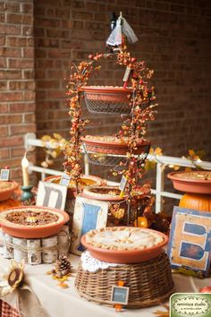 pie display at a fall wedding - like the pie stand made from birch branches tied together