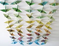 Origami paper cranes made from maps
