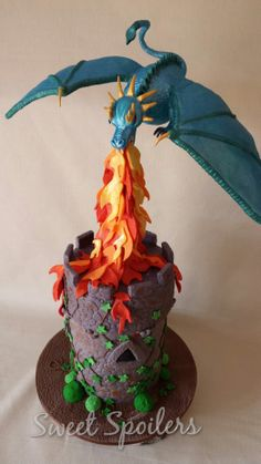 A special celebration cake, a gravity defying dragon attacking a castle, one of my favourite creations to date!