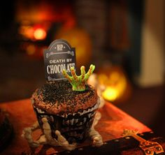 Halloween snacks featuring FREE printable gravestone cupcake toppers on http://www.chickabug.com/blog