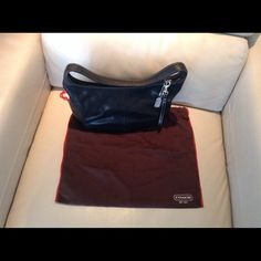 Authentic Coach Leather Bag Medium size black leather purse in great condition no rips or scratches or stains dimensions are 121/2 inch width, 8 inch length over the shoulder bag comes with original dust bag Coach Bags Shoulder Bags