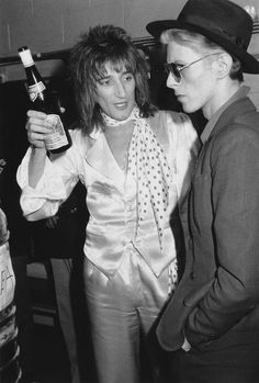 British singer Rod Stewart holds a bottle of Blue Nun wine and talks with British singer David Bowie backstage at Madison Square Garden, where Stewart performed, New York City. Stewart is wearing. Get premium, high resolution news photos at Getty Images Rod Stewart, Joey Ramone, Madison Square Garden, Keith Richards, Mick Jagger, Glam Rock, John Lennon, Rock Roll, The Thin White Duke