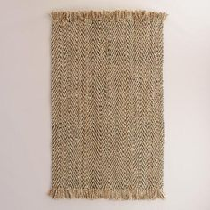 Handcrafted by artisans exclusively for World Market, our jute rug features a herringbone weave texture in a gray hue. Pleasingly soft underfoot, this natural fiber area rug is a great foundation for any room.