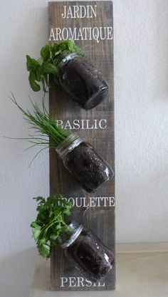 Bring the French touch to your home!  This hanging herb garden is the ideal gift for the decoration or cooking fan ! This sign is hand painted: herb garden ( jardin aromatique)at the top and the herbs correspond to basil ,  chives and  parsley. I you would like me to paint the name of different herbs that is possible and in any language too!! Please contact me before ordering in that case. The rings can be adjusted to fit various jars  Plants , jars and dirt not included !! I can ship the…
