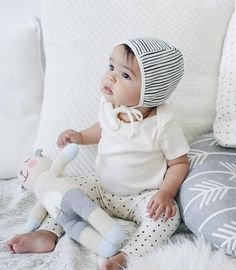 """good morning friends! we are so excited to announce that we have teamed up with the lovely ladies @petitesoulshop to bring you the """"mini bundle"""" seen here on this sweet babe! The adorable ensemble includes their petite bonnet in stripe, onesie in ivory and leggings in dot -see more of the brand new PS Signatures collection from @petitesoulshop #onminitoday *collection launches at 11AM EST wait! there is more! we are giving away two bundles -one for you and one for a friend!"""