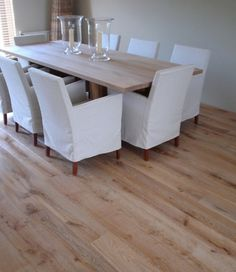 This distressed wood laminate flooring is stain-resistant and perfect for a dining room.