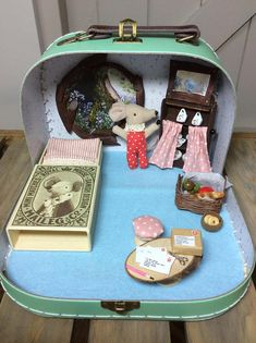 Inside this pretty pastel Sass and Belle small suitcase lies the secret little home of Sleepy Wakey Mouse. The window looks out onto Freston bluebell woods with The Sentinel oak tree just outside her front door. On the table are the replies from her friends who are invited to a