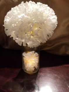 Neat and cheap centerpiece idea.  Any colors can be used. Tissue paper flowers.
