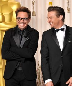 Robert Downey Jr. and Jeremy Renner at the 2013 Oscars.