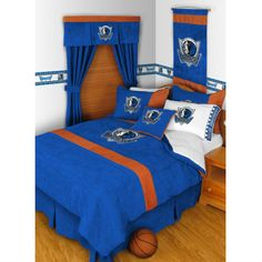 Distinct designs with licensed bedding from http://sportsdecorating.com. Decorate with bedding of your favorite team.  We at Leland's support our Mavs.  Comforters are $120.95 and other items lesser.