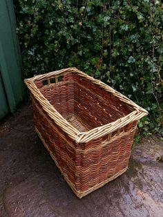 Naturally colorful Log basket by John Cowan Baskets