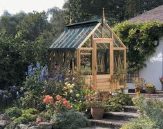 I want the outside of my greenhouse to look like this one day!!